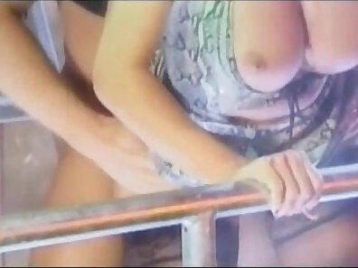blonde with a bangin ass in heels is getting on a couch