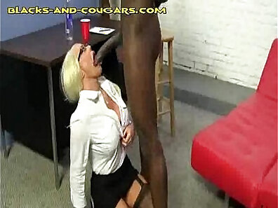 Blonde cougar sucks off black dick