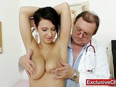Busty brunette opens up her pink vagina