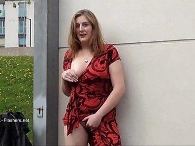 Bosomy redhead MILF likes to flash her big titties in public
