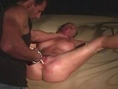 Busty Mature Lifeguard Tied To Rock