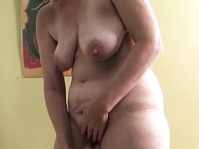Cole Mature posing in a hot and steamy masturbation video on a dildo