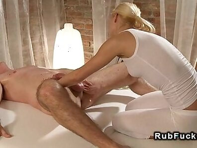Blonde getting a still cock massage from a guy