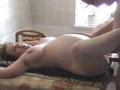 Beautiful pregnant wife pounded on kitchen sofa and fulfills
