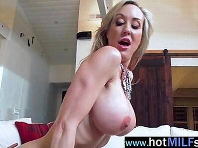 Naughty milf riding her own big cock